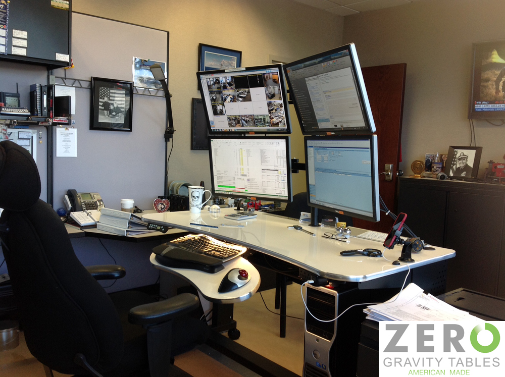 multi-monitor-computer-desk-rack-rail-configuration-4-monitors-mounted-sit-to-stand-adjustable-height-standing-desk-solution-copy.jpg
